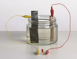 science technology/studio shot/early battery working chemical reaction zinc